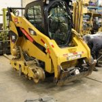 Undercarriage repair on a CAT tracked loader.